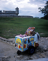 An ice cream cart sits outside of a Spanish fort in Campeche Mexico