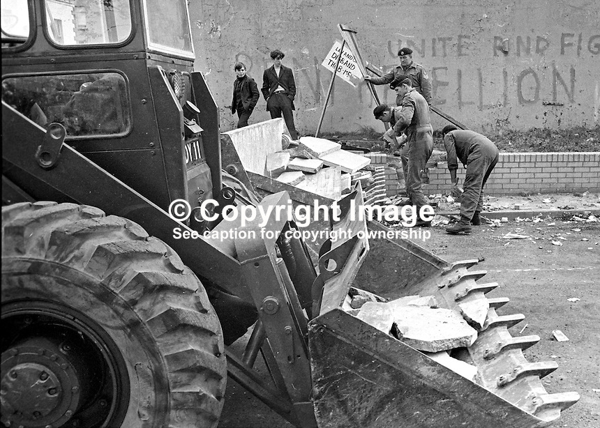 British soldiers dismantling barricades in Lower Falls area, Belfast, N Ireland, UK, 196909160252c.<br />