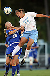 11 October 2007: North Carolina's Casey Nogueira (54) heads the ball over Duke's Kelly McCann (18). The University of North Carolina Tar Heels defeated the Duke University Blue Devils 2-1 at Fetzer Field in Chapel Hill, North Carolina in an Atlantic Coast Conference NCAA Division I Women's Soccer game.