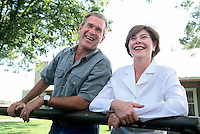 21 Jul 2000, Crawford, Texas, USA --- Republican presidential candidate George W Bush and his wife Laura on their Texas ranch. --- Image by © Brooks Kraft/Corbis
