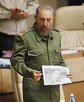 The Cuban president Fidel Castro shows the image satelital of the first tropical depression formed in the current cyclonal season during the Cuban Parliament's session. in Havana, Cuba, June 10, 2006.  . Credit: Jorge Rey/MediaPunch