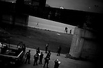 Mexican Police and U.S. Border Patrol at the scene of the shooting of a 15 year-old boy, who was killed by a U.S. Border Patrol agent in Ciudad Juarez, Chihuahua on June 7, 2010 after he had tried to cross.