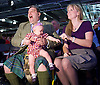 UKIP National Party Conference <br /> Day 2<br /> at Doncaster Race Course, Doncaster, Great Britain <br /> 27th September 2014 <br /> <br /> David Coburn MEP holding Nathan Gill's baby with Jana - wife of Nathan Gill <br /> <br /> Photograph by Elliott Franks <br /> Image licensed to Elliott Franks Photography Services
