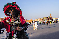 Morocco, Marrakesh. Jemaa el Fna is a square and market place in Marrakesh's medina. A water seller.