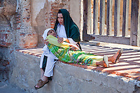 A Mother with her Dead Daughter Waiting for Jesus to Come.  Palm Sunday Re-enactment of events in the life of Jesus, by the group called Luna LLena (Full Moon), a group of volunteers in Antigua, Guatemala.