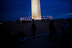 Obama Inauguration - Monday activities around the Capitol on Martin Luther King Jr. Day. The Washington Monument at dusk.