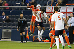 11 December 2015: Clemson's Iman Mafi (NOR) (7) heads the ball over Syracuse's Noah Rhynhart (12). The Clemson University Tigers played the Syracuse University Orange at Sporting Park in Kansas City, Kansas in a 2015 NCAA Division I Men's College Cup Semifinal match. The game ended in a 0-0 tie after overtime; Clemson advanced to the Final by winning the penalty kick shootout 4-1.