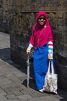 Borobudur, Java, Indonesia.  Young Indonesian Lady Visiting Borobudur Temple.