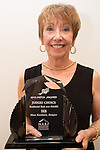 Ilona Lindauer, founder and president of IKB, holds an award from the National Association of the Remodeling Industry at the firm's downtown Los Altos office.