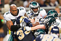 ST. LOUIS, MO - SEPTEMBER 11:   Juqua Parker #75 of the Philadelphia Eagles tackles Carnell Williams #33 of the St. Louis Rams at the Edward Jones Dome on September 11, 2011 in St. Louis, Missouri.  The Eagles defeated the Rams 31 to 13.  (Photo by Wesley Hitt/Getty Images) *** Local Caption *** Juqua Parker; Carnell Williams