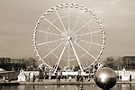 The Ferris wheel on the Place de la Concorde with the Obelisk of Luxor in the background  in Paris.