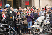 Onlookers await a sighting of President-elect of The United States Donald J. Trump outside Trump International Hotel in Washington, DC, January 19, 2017 the day before his swearing in as 45th President of The United States. <br /> Credit: Chris Kleponis / Pool via CNP