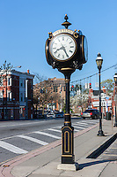 A 4-faced pedestal clock near the Harrison train station on Halstead Avenue in Harrison, New York.  The clock was manufactured by the Verdin Company.
