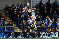 Chris Pennell of Worcester Warriors competes with Semesa Rokoduguni of Bath Rugby for the ball in the air. Aviva Premiership match, between Worcester Warriors and Bath Rugby on February 13, 2016 at Sixways Stadium in Worcester, England. Photo by: Patrick Khachfe / Onside Images