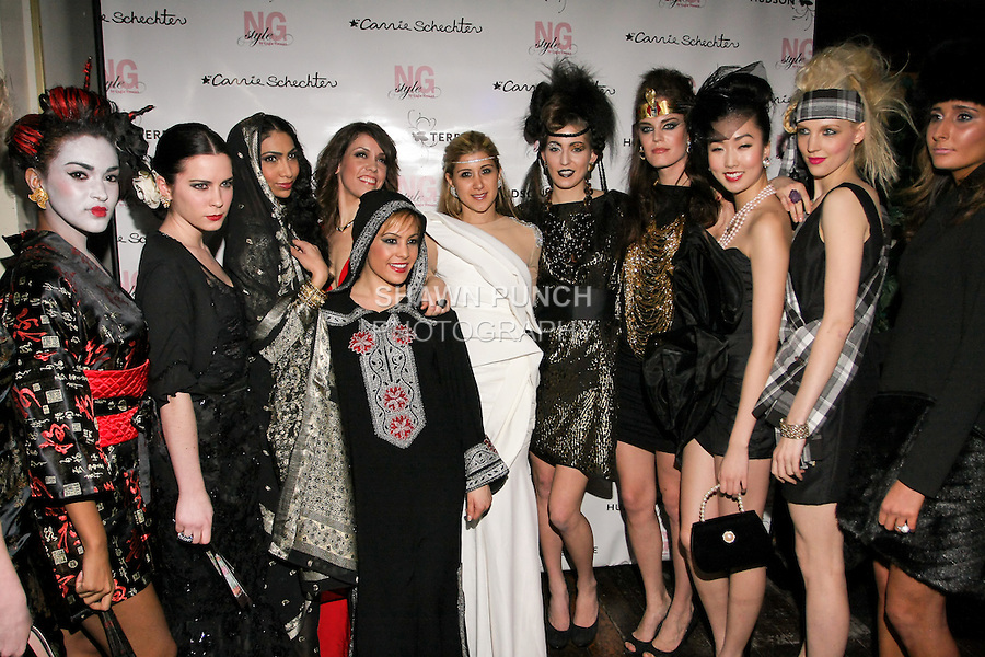 """Fashion stylist Engie Hassan (white dress), poses with models during the EngieStyle one year anniversary, """"A Tale of the Black Dress"""", fashion presentation."""