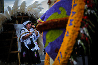 """A silletero woman rests after carrying flowers while she attends the traditional """"Silletero"""" parade during the Flower Festival in Medellin August 7, 2012. Photo by Eduardo Munoz Alvarez / VIEW."""