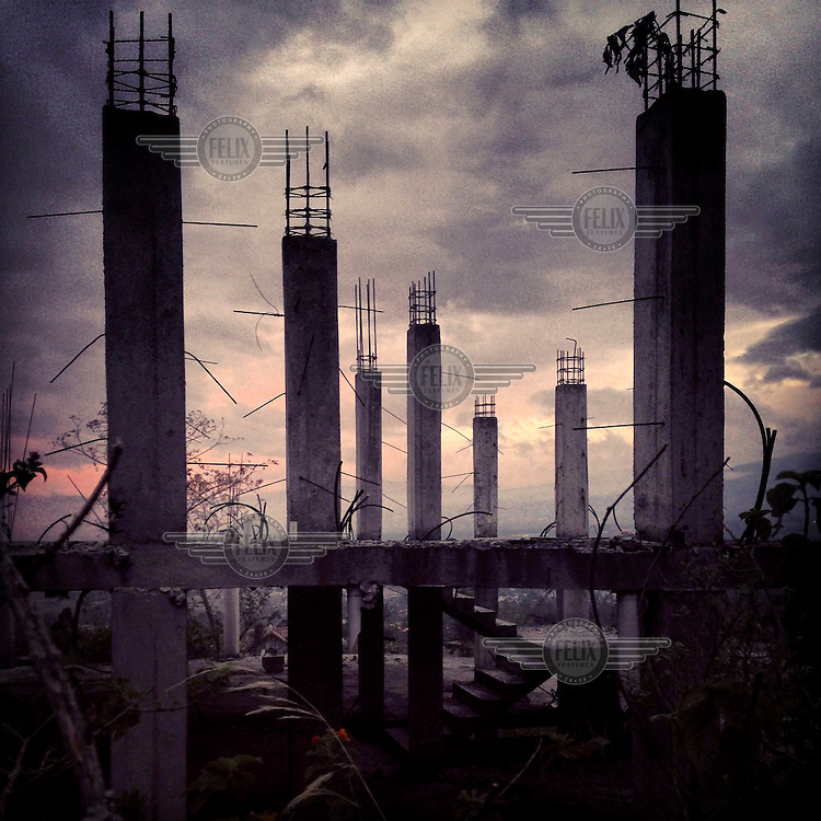 An abandoned construction project at dusk.