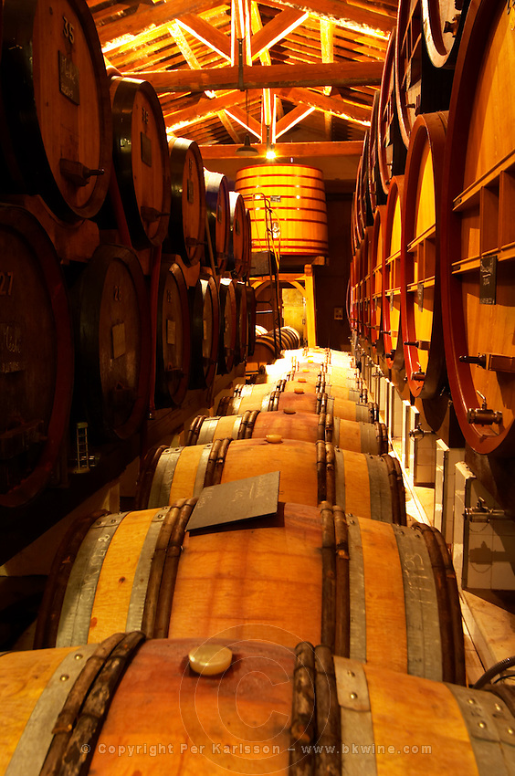 The aging cellar with oak barrels and larger wooden vats. Chateau de Beaucastel, Domaines Perrin, Courthézon Courthezon Vaucluse France Europe