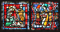 Fulbert anointed Holy Bishop by the king Robert the Pious (left) and Fulbert the theologian (right) studying religious sciences with the anchor representing stability, security and hope, from the Life of Fulbert stained glass window, in the south transept of Chartres Cathedral, Eure-et-Loir, France. This window replaces the original 13th century window depicting the Life of St Blaise, which was destroyed in 1791. It was created in 1954 by Francois Lorin as a gift of the Institute of American Architects, on a theme chosen by the Canon Yves Delaporte. It depicts the life of Fulbert, bishop of Chartres in the 11th century. Chartres cathedral was built 1194-1250 and is a fine example of Gothic architecture. Most of its windows date from 1205-40 although a few earlier 12th century examples are also intact. It was declared a UNESCO World Heritage Site in 1979. Picture by Manuel Cohen