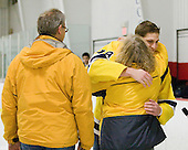 Aaron Stonacek (Bentley - 18) gives his mom a hug. - The Bentley University Falcons tied the visiting College of the Holy Cross Crusaders 2-2 on Bentley senior night on Friday, February 24, 2012, at the John A. Ryan Skating Arena in Watertown, Massachusetts.