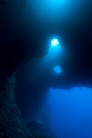 Blue Holes is one of the best dives in Palau. The light creates a cathedral like atmosphere, giving the diver a sense of vast the volume of the cave Palau Micronesia. (Photo by Matt Considine - Images of Asia Collection)