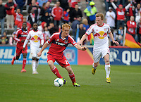 Chicago midfielder Jeff Larentowicz (20) maneuvers away from New York midfielder Dax McCarty (11).  The Chicago Fire defeated the New York Red Bulls 3-1 at Toyota Park in Bridgeview, IL on April 7, 2013.