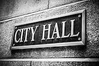 Black and white picture of Chicago City Hall sign municipal plaque on the City Hall building exterior. Photo is high resolution.