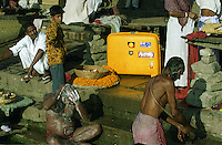 My Roncato suitcase among the Hindu bathers on the banks of the Ganges River in Varanasi, India - 1996.