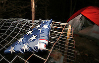 NWA Democrat-Gazette/DAVID GOTTSCHALK - 1/30/15 - A folded United States of America flag is folded outside a tent in the woods south of Martin Luther King Jr. Boulevard in Fayetteville Friday January 30, 2015 in the predawn hours. Areas with a homeless population were visited during the  Northwest Arkansas' biennial, 24-hour h