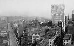 Pittsburgh PA: View of City from the top of the Empire Building - 1904. View of the city looking up Liberty Avenue towards the Pennslyvania Railroad Station. The Farmers Bank Building is on the right. View of three sets of trolley tracks on Liberty Avenue. Company signs on city buildings included: C.A. Verner Shoes, CA Verner Shoes, Home Trust Company of Pittsburgh, JC Lindsay Hardware Company, John Wallace Produce, JR Weldin & Company Stationery, Lyle Bros Hardware, Monogahela National Bank, Pittsburgh Coal company sign, Renwick Bros Wholesale Millinery, Rosenbaum Company