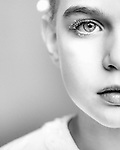 Close up of young girls face with clear eyes