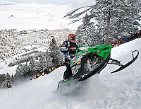 NEWS&amp;GUIDE PHOTO / PRICE CHAMBERS.Kyle Tapio speeds to the top of Snow King on Sunday as he competes for the King of Kings title. From Battle Ground, Wash., Tapio won the top seat at the World Championship Snowmobile Hill Climb for the third time in four years. For his last run he posted a time of 1 minute and 4.978 seconds.