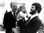 President Gerald Ford greets Ron Bennett Photojournalist and son Tom Bennett in the White House Oval Office,