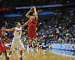 Ole Miss' Marshall Henderson (22) vs. Florida's Scottie Wilbekin (5) in the SEC championship game at Bridgestone Arena in Nashville, Tenn. on Sunday, March 17, 2013.