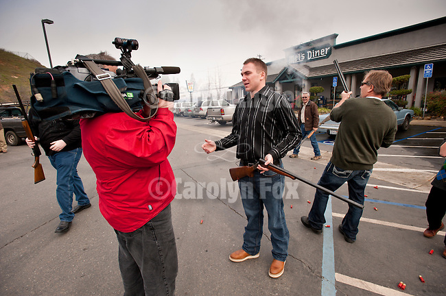 KCRA TV's Will Heryford from Sacramento films the story as Beau Gillman explains the traditon of the shotgun-toting locals shooting in Jackson, California. The locals gathered on Main Street, and at Mel's Drive-in restaurant to fire off rounds during Jackson Serbian community's celebration on January 7.