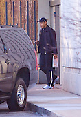 Chicago, IL - November 28, 2008 -- United States President-elect Barack Obama heads back to his car after working out in the Regents Park Apartments in Chicago, IL on Friday, November 28, 2008. He is holding a copy of the New York Times and a Blackberry..Credit: Ralf-Finn Hestoft - Pool via CNP