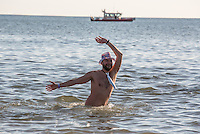 BROOKlLYN, NY - JANUARY 01 : A man dances in the water during the annual Coney Island Polar Bear Club New Year's Day swim by running into the ocean at Coney Island , Brooklyn on January 01, 2017. Photo by VIEWpress/Maite H. Mateo.