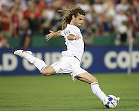 Kyle Beckerman #5 of the USA winds up for a shot during a CONCACAF Gold Cup match against Honduras at RFK Stadium on July 8 2009 in Washington D.C. USA won the match 2-0.
