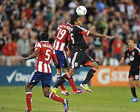 D.C. United forward Lionard Pajoy (26) heads the ball against Chivas USA defender Jorge Villafana (19) D.C. United defeated Chivas USA 1-0 at RFK Stadium, Sunday September 23, 2012.