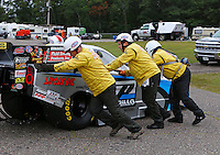 Aug 17, 2014; Brainerd, MN, USA; Members of the Safety Safari help push NHRA top alcohol funny car driver Shane Westerfield off the track during the Lucas Oil Nationals at Brainerd International Raceway. Mandatory Credit: Mark J. Rebilas-