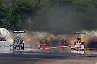Aug. 18, 2013; Brainerd, MN, USA: NHRA top fuel dragster driver Terry McMillen (left) races alongside Clay Millican during the Lucas Oil Nationals at Brainerd International Raceway. Mandatory Credit: Mark J. Rebilas-