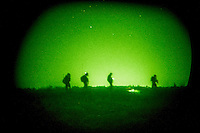 ISKANDARIYA, IRAQ - JULY 15: US soldiers patrol a marsh-like field as units with the 509th Infantry Division and the 3rd Infantry's Aviation Brigade launch a joint air assault, raiding over 30 targeted areas in a large rural area near Iskanderiyah on July 15, 2007 in Iskandariya, Iraq. The raid targeted IED production and a search for suspected insurgets. The area south of Baghdad has had little US army presence in the last 6 months, and is considered a haven for Al Qaeda in Iraq. (Photo by Benjamin Lowy/Reportage by Getty Images)