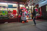 A discount store in the Astoria neighborhood of Queens in New York displays its Christmas merchandise, seen on Thursday, December 13, 2012. There's only twelve more days left to buy those discounted gifts for your loved ones. (© Richard B. Levine)
