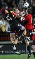 Chiefs' Tim Nanai-Williams, left, and Robbie Robinson jump against Crusaders' Richie McCaw for the ball in the semi-final Super Rugby match, Waikato Stadium, Hamilton, New Zealand, Friday, July 27, 2012.  Credit:SNPA / David Rowland
