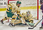 17 December 2013:  University of Vermont Catamount Goaltender Mike Santaguida, a Freshman from Mississauga, Ontario, makes a third period save against the Northeastern University Huskies at Gutterson Fieldhouse in Burlington, Vermont. The Huskies shut out the Catamounts 3-0 to end UVM's 5 game winning streak. Mandatory Credit: Ed Wolfstein Photo *** RAW (NEF) Image File Available ***