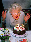 "staff photo by Phil Grout..Mrs. ""Howard"" W. Hubbard of Edenwald, Towson, rears back and gets.ready to blow out her birthday candles during a celebration of her.86th birthday following dinner last Friday.   Before her retirement, .""Howard"" was employed by the Enoch-Pratt Library."