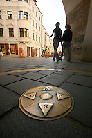Europe, Slovakia, capitol city - Bratislava, Michael tower gate with compass rose inlaid in street..