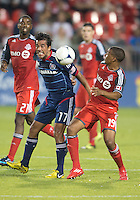 12 September 2012: Chicago Fire midfielder Pavel Pardo #17 and Toronto FC midfielder Reggie Lambe #19 in action during an MLS game between the Chicago Fire and Toronto FC at BMO Field in Toronto, Ontario Canada. .The Chicago Fire won 2-1.