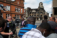 A television news broadcast takes place in front a burnt out building where rioting took place two nights earlier in Tottenham, London borough of Haringey. London saw the beginnings of riots on Saturday evening, after a peaceful protest in response to the shooting by police of Mark Duggan during an attempted arrest, escalated into violence. By the third night of violence, rioting had spread to many areas of the capital and to other cities around the country.