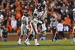 Ole Miss' Kentrell Lockett (40) celebrates with Ole Miss' Charles Sawyer (3) after recovering a fumble by Auburn running back Onterio McCalebb (23) at Jordan-Hare Stadium in Auburn, Ala. on Saturday, October 29, 2011. .
